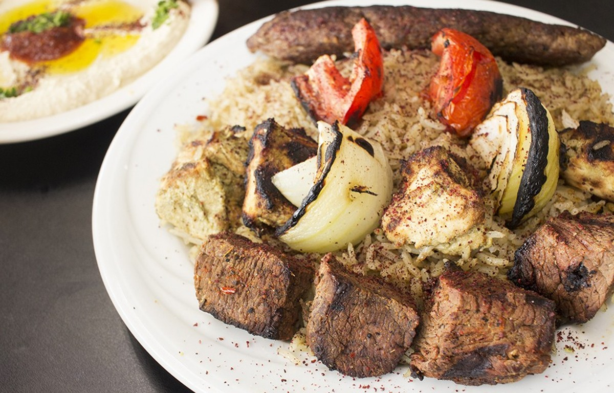 A combo plate with shish kebob, kefta kebob and shish tawook.