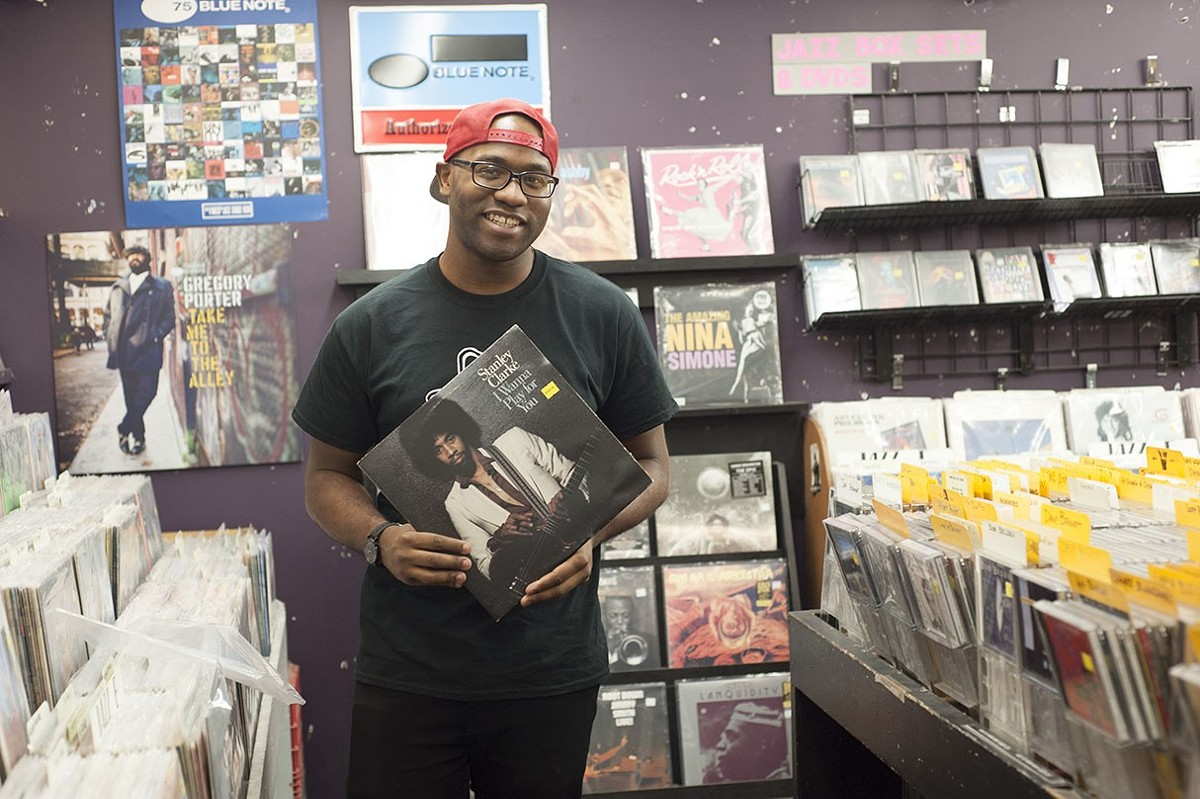 """Orlandez Lewis first got hired at Vintage Vinyl — his """"dream job"""" — at the age of eighteen."""