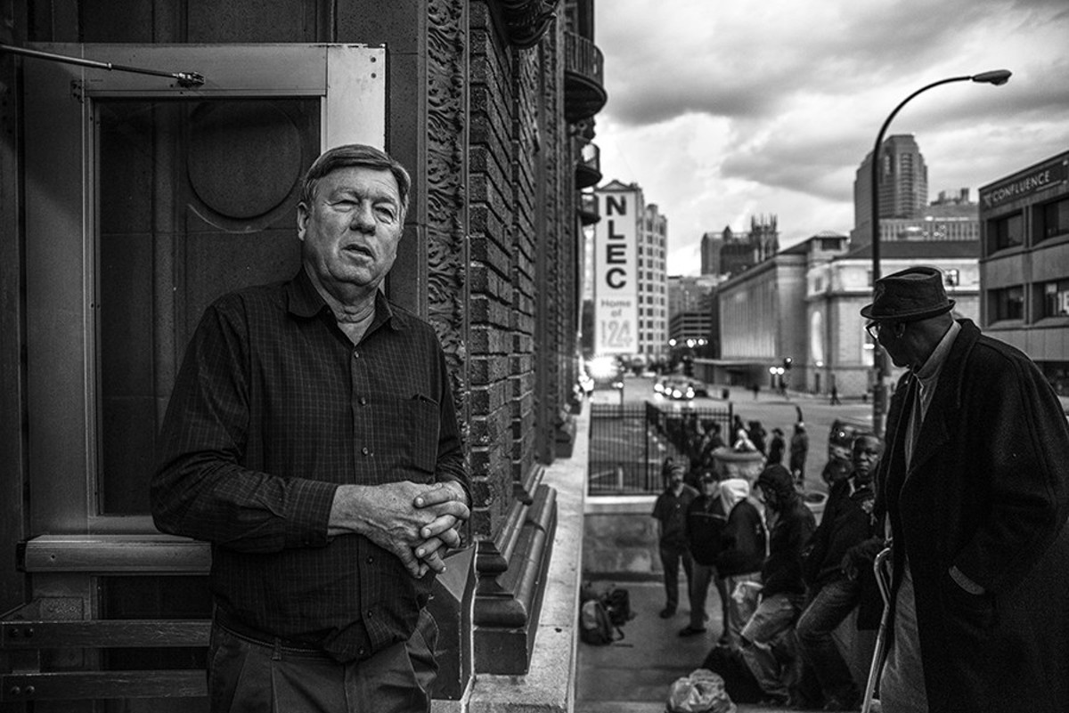 Rev. Larry Rice looks out the front door of the New Life Evangelistic Center as homeless men wait in line for potential beds for the night on November 14.