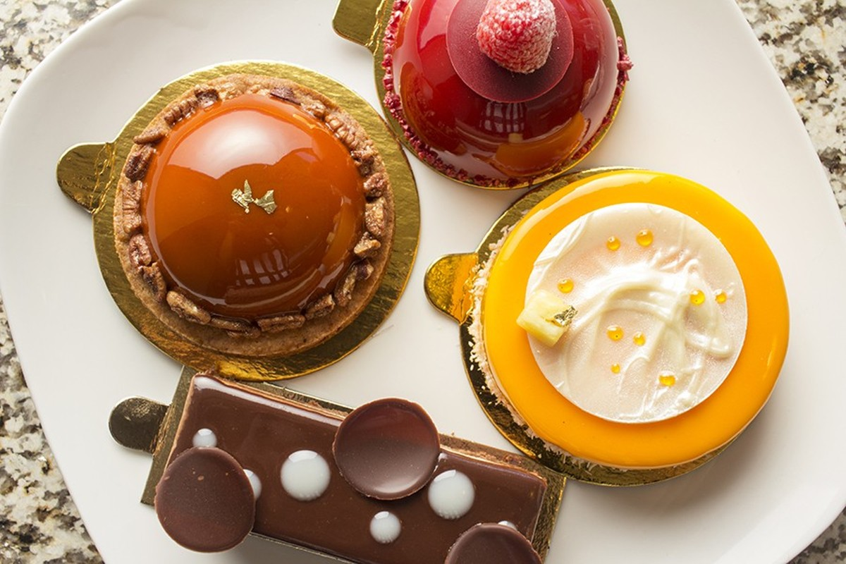 "Individual cakes include the ""Amber"" with pecan caramel, sablé breton, vanilla bean mousse and caramelized pecans."