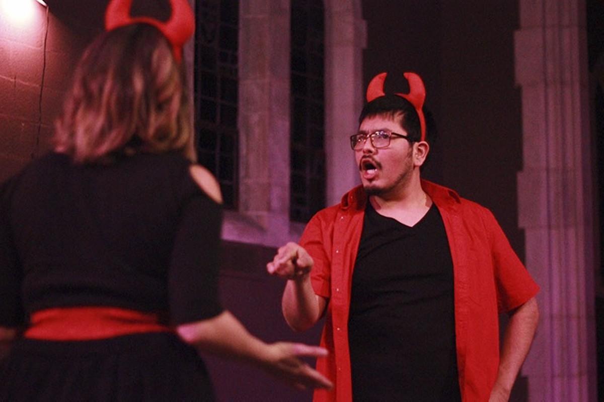 Sam (Rahamses Galvan) discusses punishment options with his co-devil Lily (Elizabeth Van Pelt).