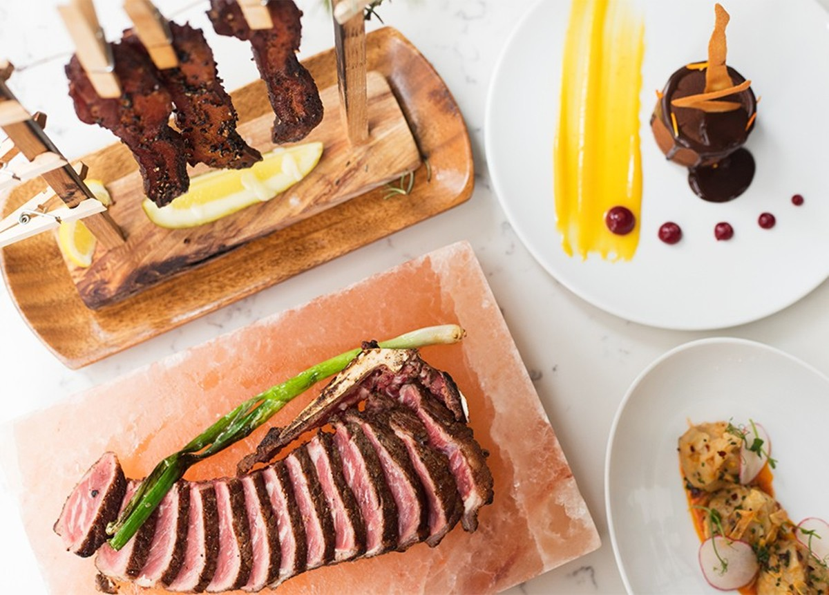 """Grand Tavern's highlights include """"Clothesline Bacon,"""" dark chocolate mousse """"Radio City Rockette style,"""" a bone-in New York strip steak and """"Emotional Lobster Dumplings."""""""