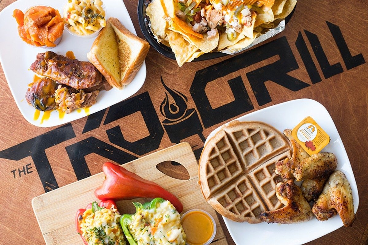 "A selection of items from TKO Grill (pictured from top left to right): ""On The Ropes"" turkey ribs combo, ""Uppercut"" nachos, stuffed peppers and ""Pluck 'N' Waffles,"" a chicken and waffles combo."