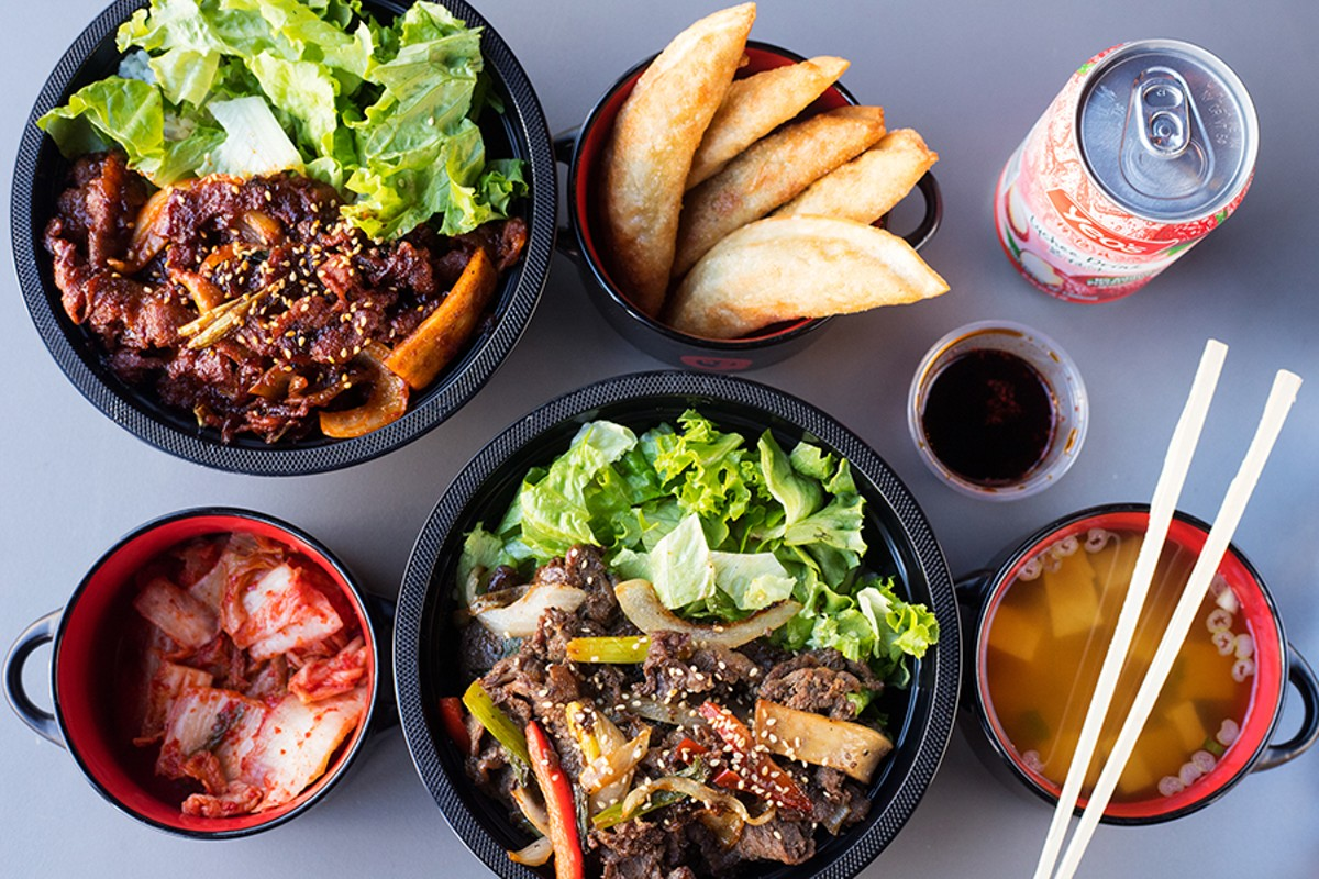 A selection of items from BoBQ, pictured from left to right: spicy pork bowl, dumplings, lychee beverage, kimchi, beef bulgogi bowl and miso soup.