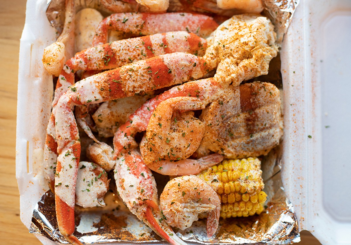 All of Crawling Crab's shellfish — the lobster, crab and shrimp — are served as part of a platter that includes pieces of mild, Polish-style sausage, hard-boiled eggs, corn and potatoes.