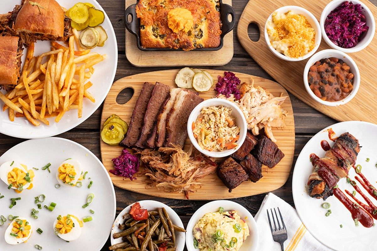 A selection of items from Knockout BBQ, pictured from left to right, top to bottom: loaded pulled pork sandwich, jalapeño-blueberry cornbread, mac 'n' cheese, slaw, pit beans, deviled eggs, meat combo, Texas Twinkie, roasted green beans and tomatoes and egg and mustard potato salad.