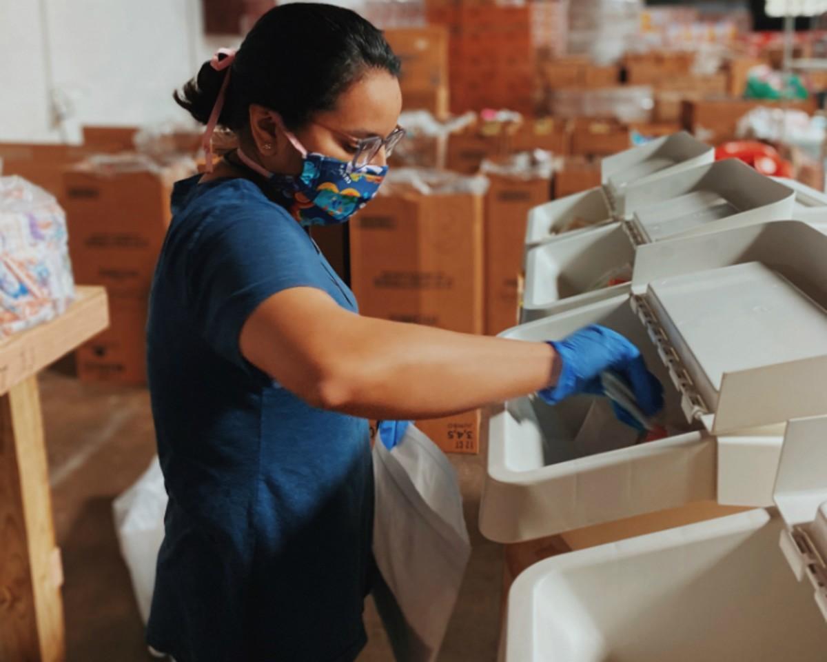 Diaper Bank warehouse specialist Prasama Dhakal packing kits.