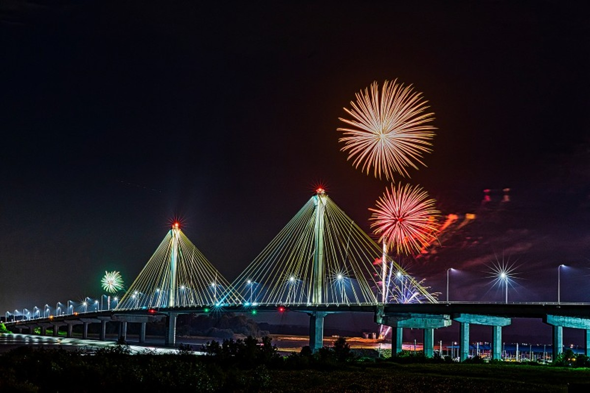 The fireworks in Alton light up the sky.