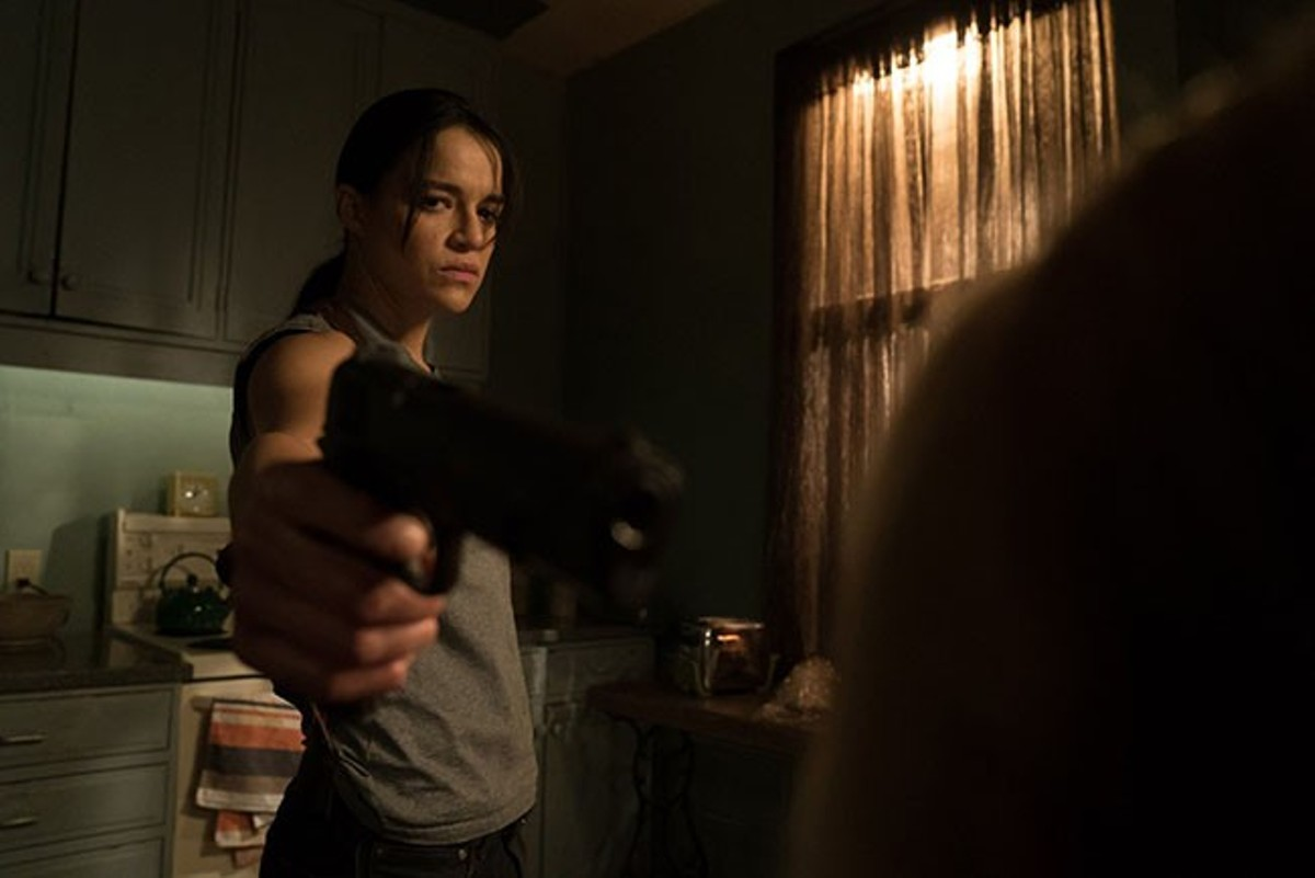 Michelle Rodriguez is hitman turned hitwoman.