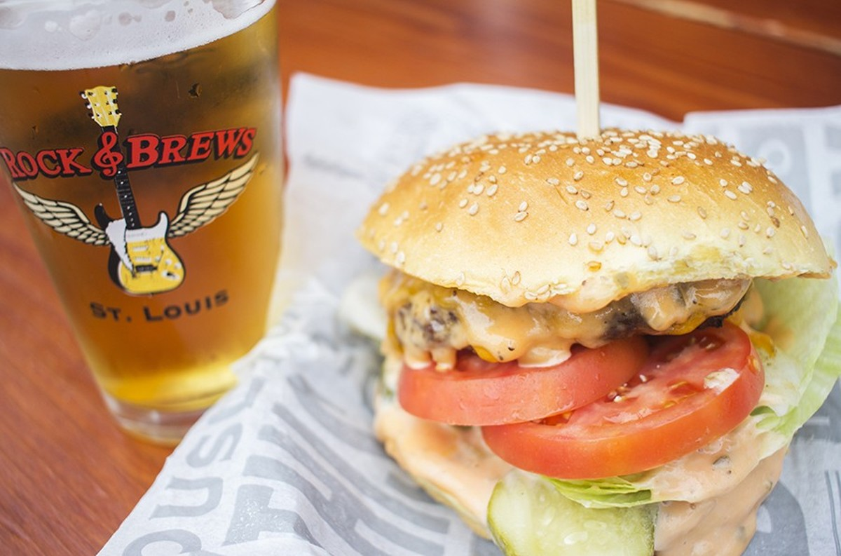 """Rock & Brews' """"Ultimate Burger"""" with cheddar, caramelized onions, pickles and thousand island dressing on a sesame-brioche bun."""