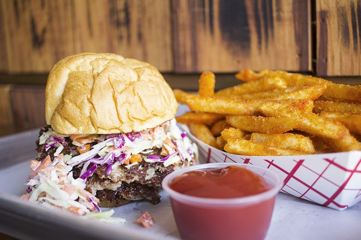 Mac's triple pork burger comes with housemade aioli, pickles, onions and slaw on a buttered and toasted Vitale's egg bun.