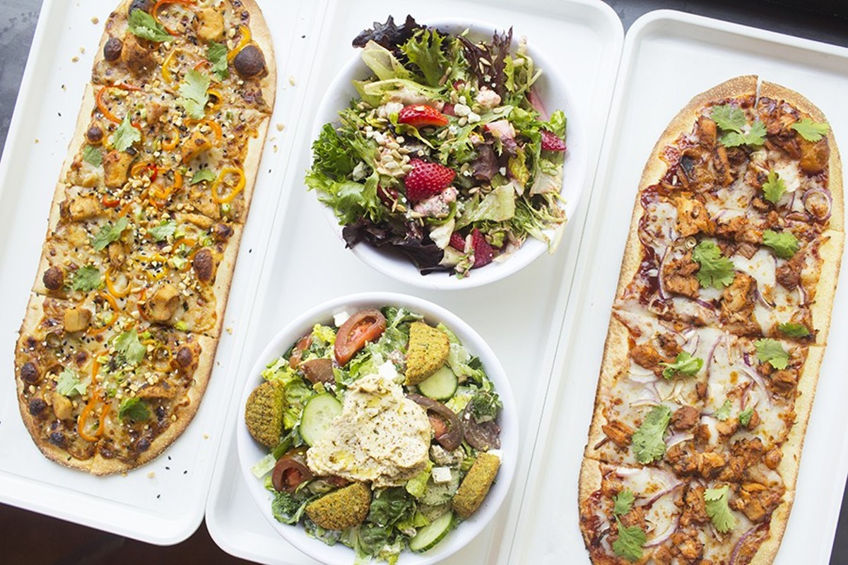 "Pies at 'Zza include the ""Thai Dye"" (left) and ""Postrio"" (right), as well salads and even a poke bowl."