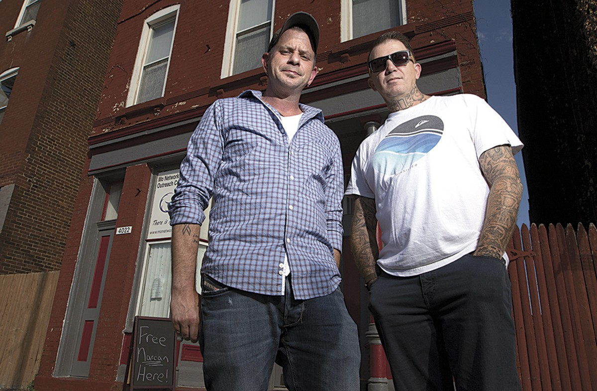 Chad Sabora and Robert Riley II, co-founders of the Missouri Network for Opiate Reform and Recovery, stand outside their outreach center on Broadway.
