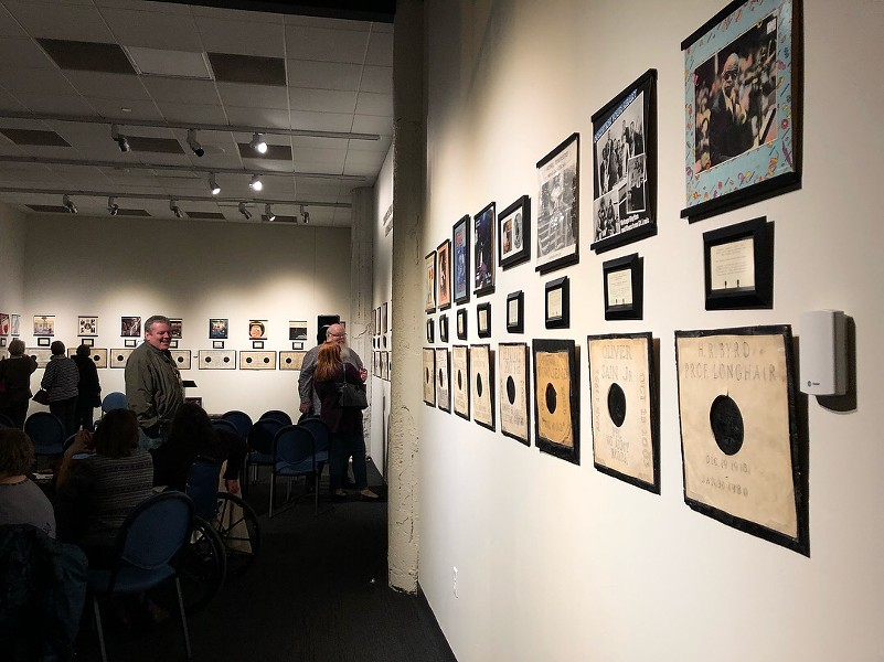 "A visiting group gets the first peek at ""See That My Grave Is Kept Clean,"" on display at the National Blues Museum through May 19. - PHOTOS COURTESY OF THE NATIONAL BLUES MUSEUM"