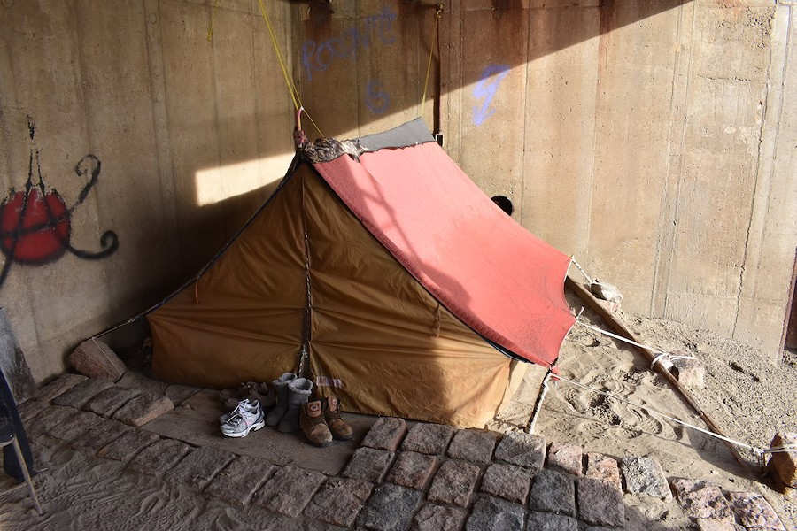 A small homeless camp has been erected in an alcove of the flood wall. - DOYLE MURPHY