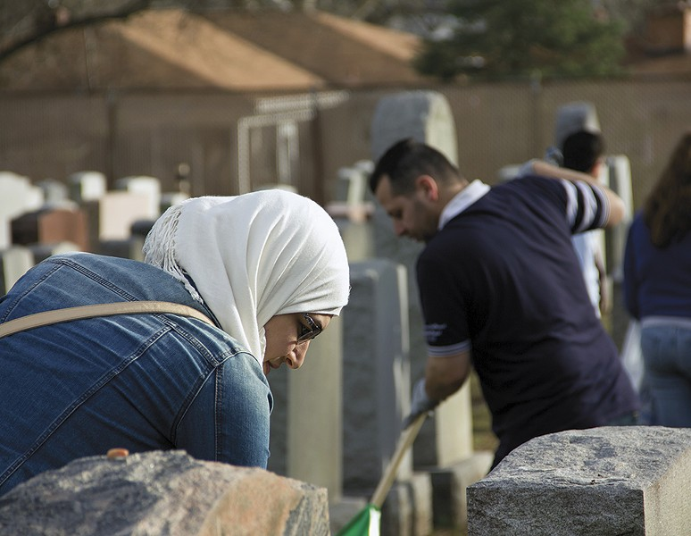 Muslims and Jews worked side by side to clean up a cemetery after the February 2017 vandalism. - DANNY WICENTOWSKI