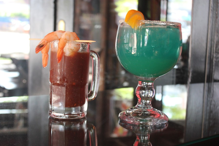 "A michelada, left, and a ""Blue Magic"" margarita, made with Tarantula Tequila. - SARAH FENSKE"