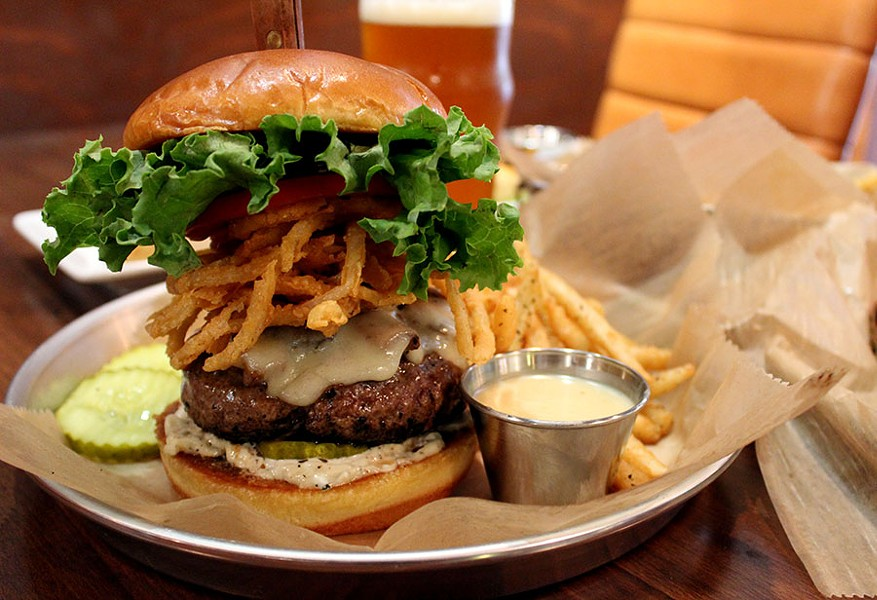 The Mushroom Swiss Stuffed Burger is a signature cheese-stuffed patty, mushrooms, Swiss cheese, blue cheese and black pepper mayo and fried onions for $12.50 - LEXIE MILLER