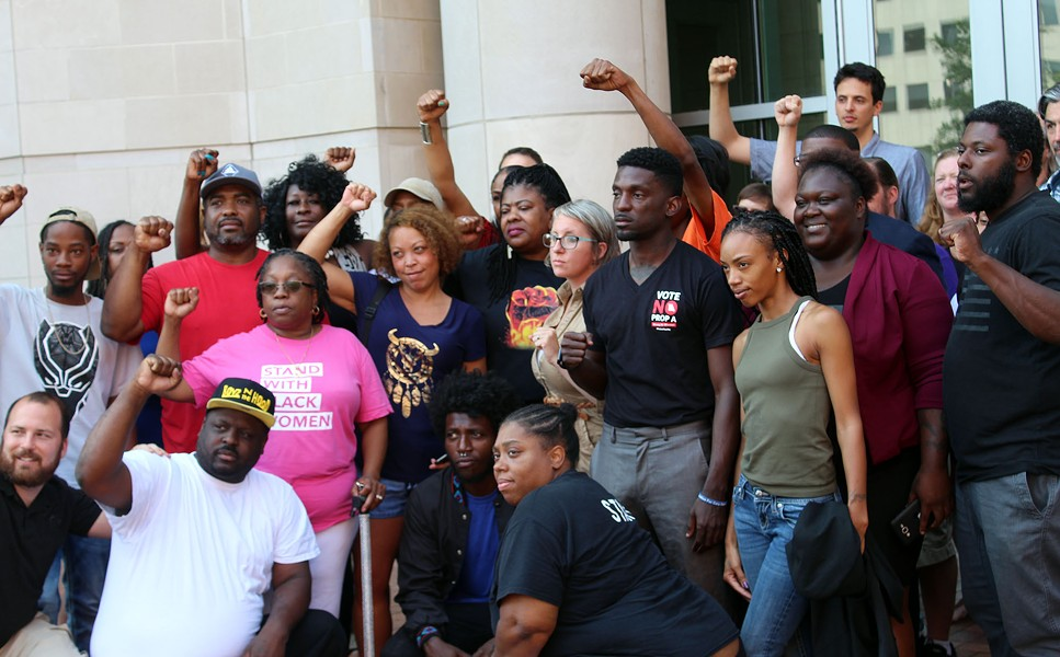Supporters of Josh Williams pose for a photo after a press conference on August 3. - LEXIE MILLER