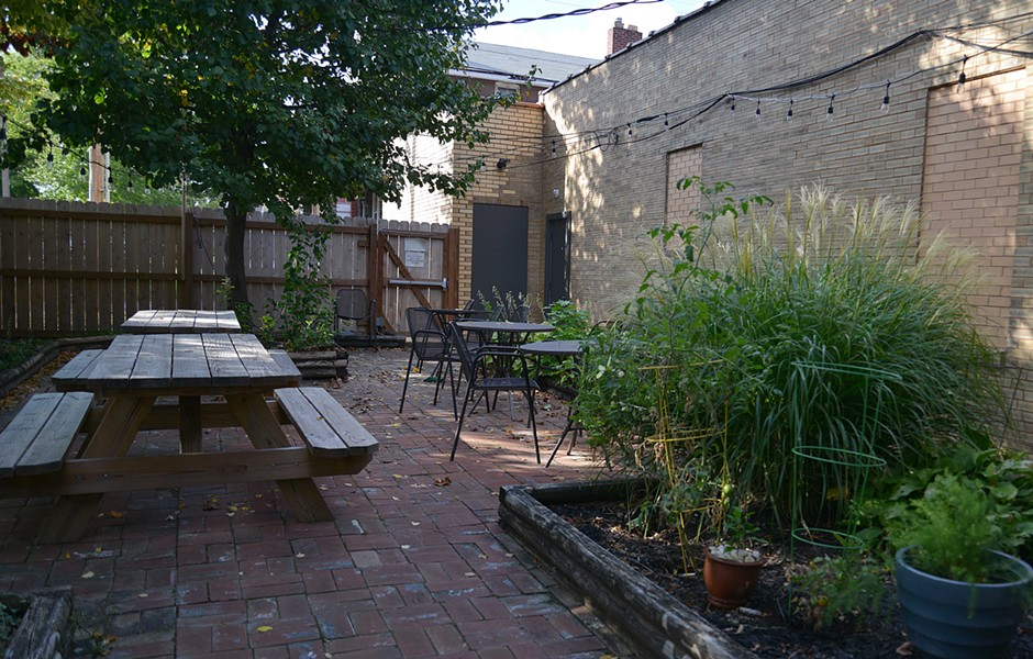 The patio out back seats around 25 at various picnic and cast iron tables. - TOM HELLAUER