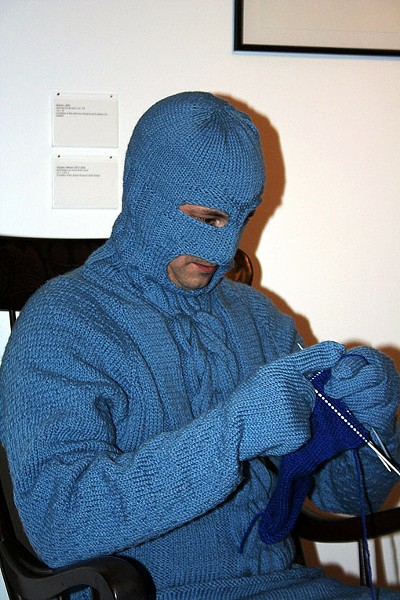 Mark Newport as Sweaterman, knits while in-character on Friday night. - PHOTO: EMILY GOOD
