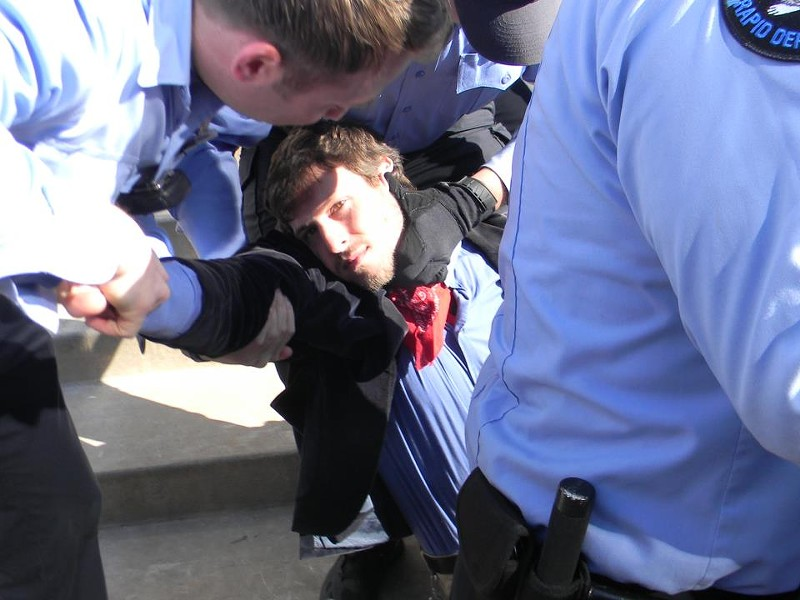 Peabody protester getting arrested in St. Louis. - VIA FACEBOOK