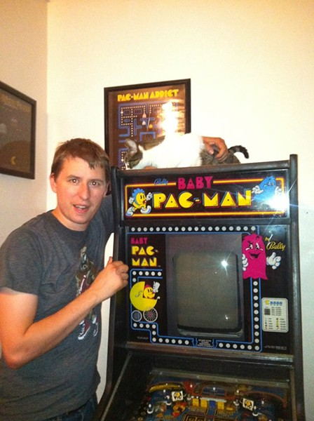 Chris Ward and his Baby Pac-Man machine. - PHOTOS COURTESY OF CHRIS WARD
