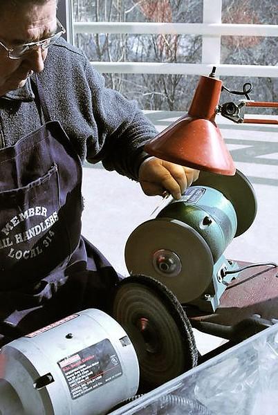 Knife-sharpening while you shop. - PHOTO: MATT BLICKENSTAFF