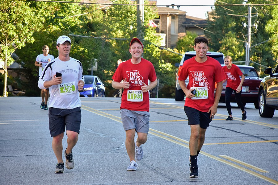 Cort VanOstran, center, jogs the Fair Maps 5K in Clayton with running buddy Jason Growe, left, and campaign staffer Alex Dubinsky. - DOYLE MURPHY