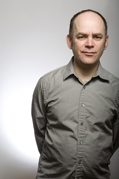 "Todd Barry looking ""playfully fed-up."" - PHOTO BY FRANCINE DAVETA"