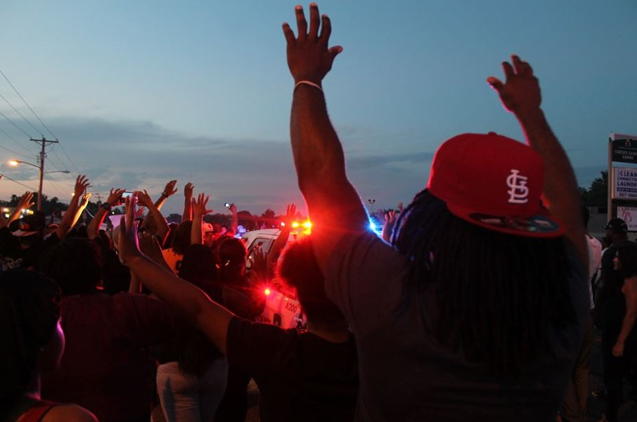"Protesters with ""hands up."" - RAY DOWNS"