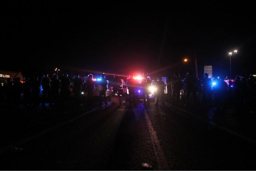 Police form a barricade. - RAY DOWNS