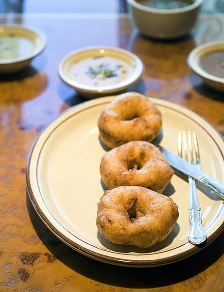 Medu Vada, donut-like in appearance, are deep fried lentil cakes. See photo slideshow from Mayuri. - PHOTO: JENNIFER SILVERBERG