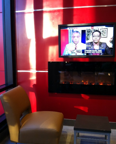 "Leather chairs, flat-screen TVs and a recessed fireplace at new ""ultra modern"" Wendy's. - LIZ MILLER"