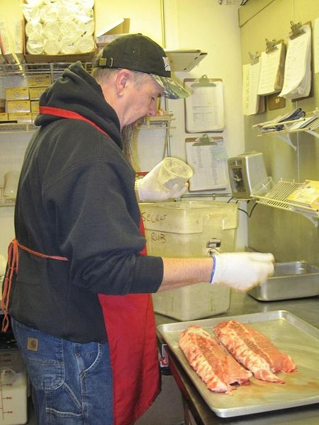 Mike Emerson, co-owner of Pappy's Smokehouse, hard at work - ROBIN WHEELER