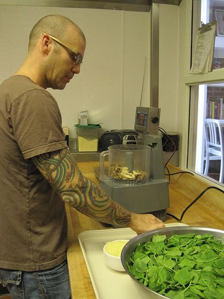 Josh Allen prepares his spinach-walnut pesto. - ROBIN WHEELER