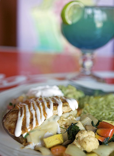 The Las Palmas stuffed chicken is chicken stuffed with spinach, mushrooms, onions, pepperjack cheese and in a spicy diablo sauce. It is served with cilantro rice, veggies, guacamole, sour cream and pico de gallo. See the full slideshow here. - PHOTO: JENNIFER SILVERBERG