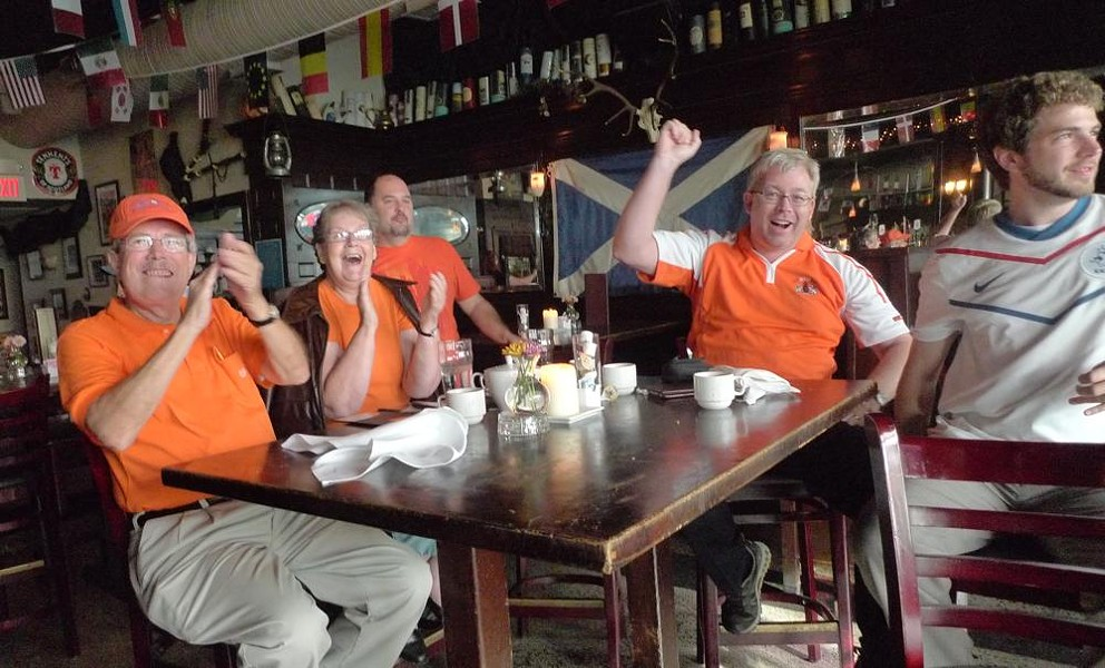 Netherlands fans cheer for goals...and pasties. - PHOTOS BY KEEGAN HAMILTON