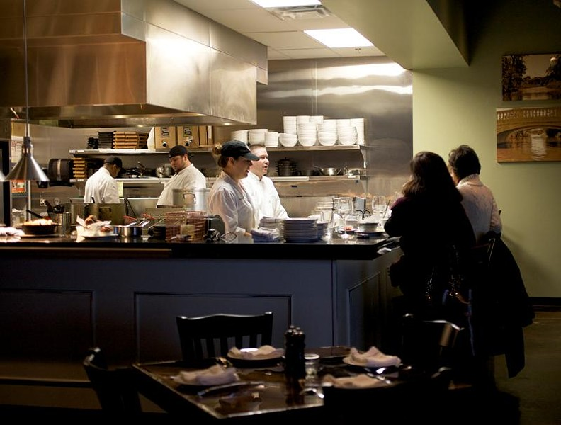 The open kitchen, with seating, at the Tavern Kitchen & Bar in Valley Park - JENNIFER SILVERBERG