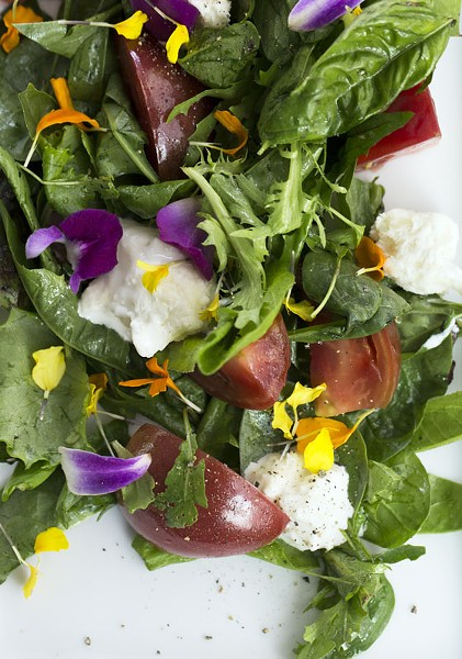 Local tomato salad with stracciatella, basil and spinach. | Jennifer Silverberg
