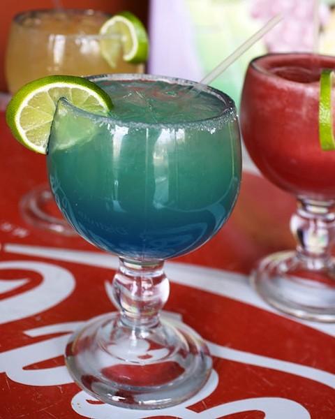 Clockwise from upper-left corner: Las Palmas Margarita (Hornitos, Orange Curacao), Frozen Strawberry Margarita and the Blue Sky Margarita (Sauza Gold, Blue Curacao). - JENNIFER SILVERBERG