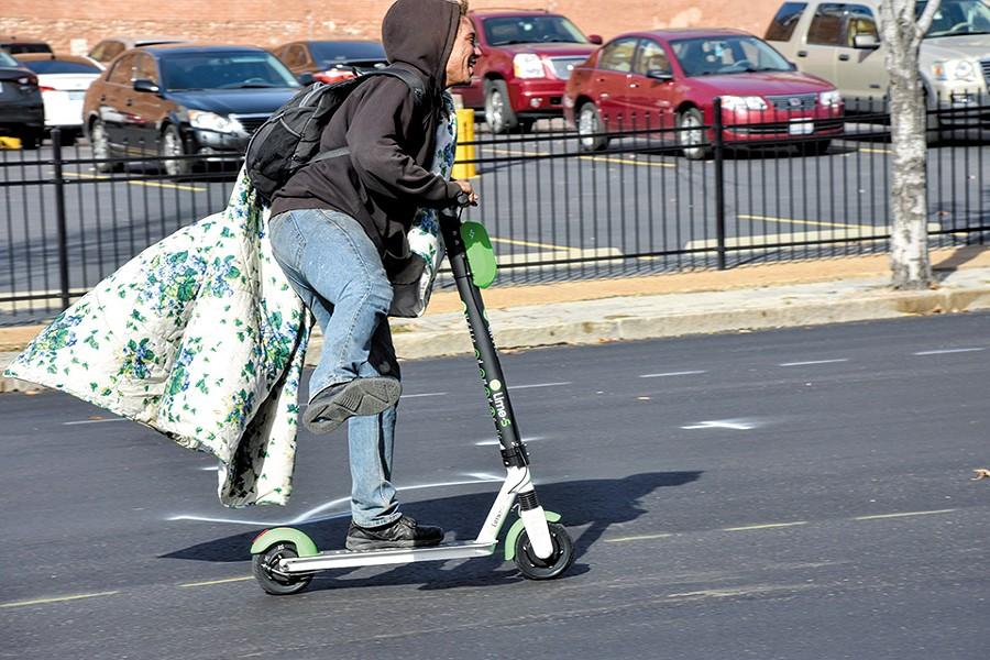 An unlocked Lime scooter give Jaz a few minutes of joy. - DOYLE MURPHY