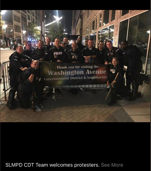 St. Louis riot police pose after kettling protesters in a photo posted to social media and later included in court filings. - COURT FILING