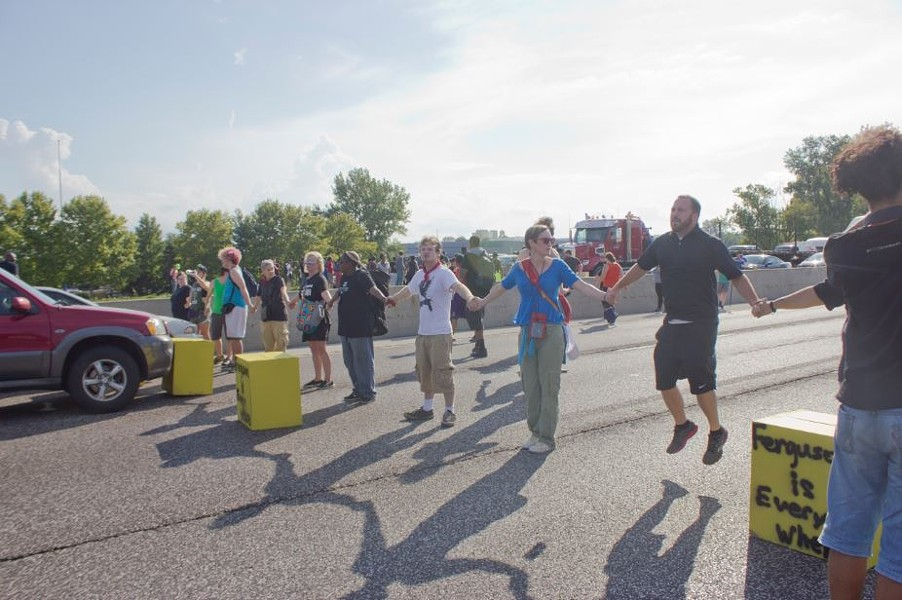 More than 60 protesters were arrested Monday after blocking rush-hour traffic on I-70. - DANNY WICENTOWSKI