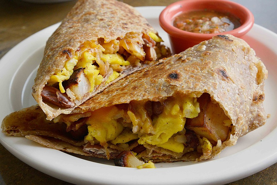 The breakfast burrito features egg, bacon, cheese, potato, kidney beans and homemade salsa on the side. - TOM HELLAUER