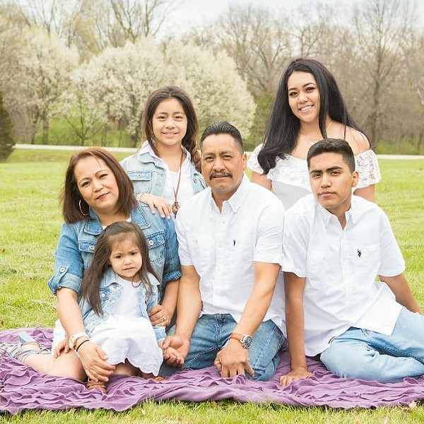 Wilian Ramos, center, with his family. - COURTESY OF RAMOS LANDSCAPING LLC