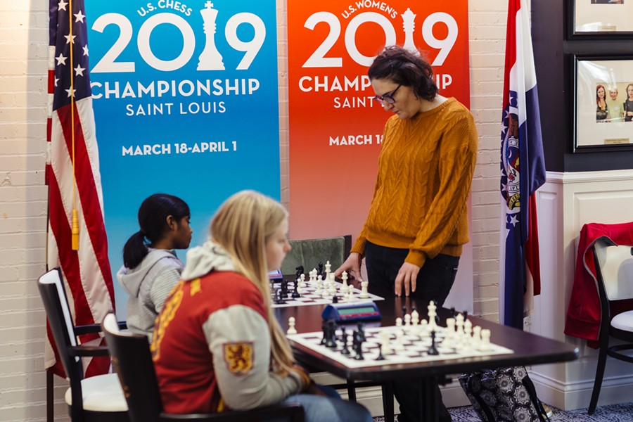 Former World Blitz Champion Nana Dzagnidze, standing, plays a match with a local Girl Scout. - COURTESY OF THE SAINT LOUIS CHESS CLUB