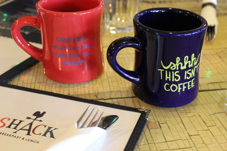 You can buy the Shack's coffee mugs for $10 each. - PHOTO BY LAUREN MILFORD
