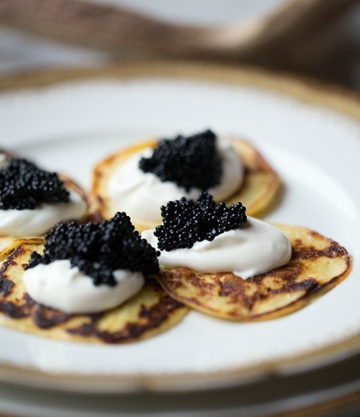 Bar Les Freres' potato blinis with caviar and creme fraiche. - PHOTO BY JENNIFER SILVERBERG