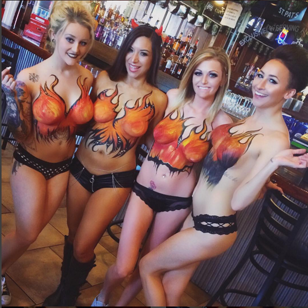 Servers at Social House's original location, in Soulard, show off the body paint that the bar is known for. - PHOTO COURTESY OF INSTAGRAM/SOCIAL HOUSE STL